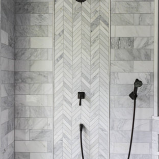 Example of a large master gray tile and marble tile marble floor, white floor, double-sink, vaulted ceiling and wood wall bathroom design in Philadelphia with medium tone wood cabinets, a bidet, gray walls, an undermount sink, quartzite countertops, a hinged shower door, white countertops and a built-in vanity