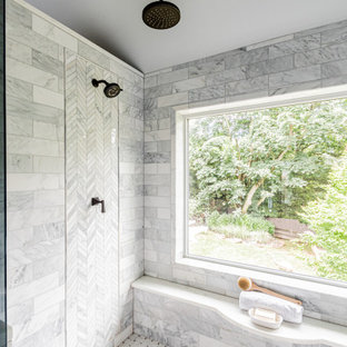 Bathroom - large master gray tile and marble tile marble floor, white floor, double-sink, vaulted ceiling and wood wall bathroom idea in Philadelphia with medium tone wood cabinets, a bidet, gray walls, an undermount sink, quartzite countertops, a hinged shower door, white countertops and a built-in vanity