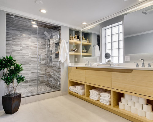 contemporary gray tile beige floor alcove shower idea in oklahoma city with flat panel cabinets
