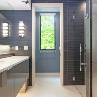 Walk-in shower - mid-sized contemporary master blue tile and porcelain tile porcelain floor, beige floor, single-sink and wallpaper ceiling walk-in shower idea in Grand Rapids with flat-panel cabinets, green cabinets, a two-piece toilet, blue walls, an undermount sink, quartzite countertops, a hinged shower door, white countertops and a floating vanity