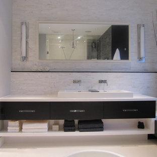 Esempio di una stanza da bagno minimalista con lavabo rettangolare, ante lisce, ante in legno bruno e piastrelle bianche
