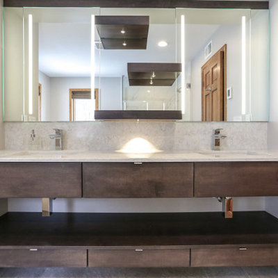 Inspiration for a mid-sized modern master gray tile and marble tile gray floor and marble floor bathroom remodel in Minneapolis with open cabinets, dark wood cabinets, gray walls, an undermount sink, quartz countertops, a hinged shower door, gray countertops and a two-piece toilet