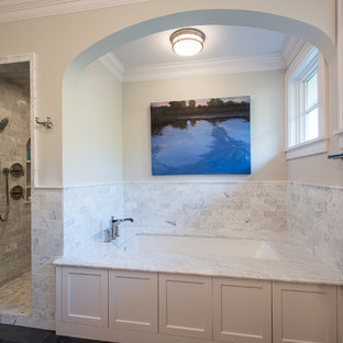 Example of a large transitional master white tile and subway tile slate floor doorless shower design in Other with recessed-panel cabinets, white cabinets, granite countertops, an undermount tub, an undermount sink, a two-piece toilet and gray walls