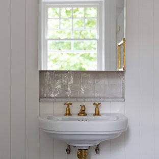 Inspiration for a farmhouse bathroom in London with white walls and a wall-mounted sink.