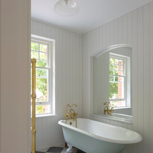 Medium sized country bathroom in London with a claw-foot bath and multi-coloured floors.