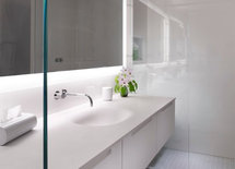 Glass wall next to vanity