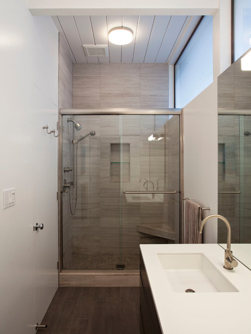 midcentury modern gray tile alcove shower photo in san francisco with an undermount sink