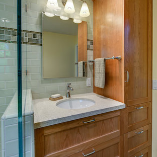 Photo of a small traditional 3/4 bathroom in San Francisco with an undermount sink, shaker cabinets, medium wood cabinets, engineered quartz benchtops, a corner shower, a two-piece toilet, green tile, ceramic tile, yellow walls, mosaic tile floors, white floor, a sliding shower screen, beige benchtops, a niche, a shower seat, a single vanity and a built-in vanity.