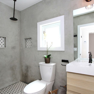 Doorless shower - small eclectic 3/4 multicolored tile and ceramic tile ceramic tile doorless shower idea in Los Angeles with an integrated sink, flat-panel cabinets, light wood cabinets, solid surface countertops, an urinal and gray walls