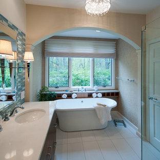 Diseño de cuarto de baño principal, contemporáneo, de tamaño medio, con armarios con paneles lisos, puertas de armario de madera en tonos medios, bañera exenta, ducha esquinera, baldosas y/o azulejos azules, azulejos en listel, paredes grises, suelo de baldosas de cerámica, lavabo bajoencimera y encimera de cuarzo compacto