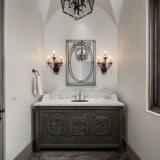 Inspiration for a huge mediterranean master medium tone wood floor and gray floor bathroom remodel in Phoenix with marble countertops, furniture-like cabinets, gray cabinets, white walls, an undermount sink and white countertops
