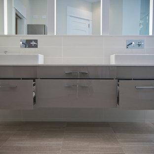 Bathroom - contemporary bathroom idea in Grand Rapids with a vessel sink