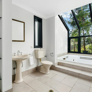 Mid-sized transitional master bathroom in Sydney with a drop-in tub, a one-piece toilet, white walls, ceramic floors and beige floor.