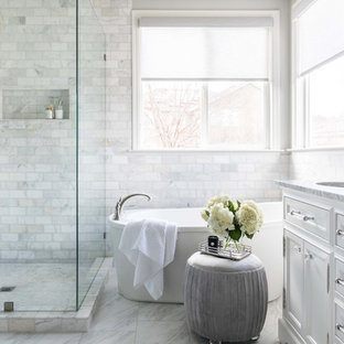 Example of a mid-sized transitional master white tile and marble tile marble floor and white floor freestanding bathtub design in Sacramento with white cabinets, gray walls, an undermount sink, marble countertops, a hinged shower door, white countertops and recessed-panel cabinets