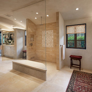 Photo of a large mediterranean ensuite bathroom in Santa Barbara with shaker cabinets, white cabinets, a freestanding bath, a walk-in shower, beige tiles, mosaic tiles, beige walls, limestone flooring, a submerged sink and marble worktops.