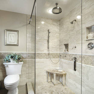 Inspiration for a timeless beige tile and marble tile corner shower remodel in Miami with a two-piece toilet and a niche