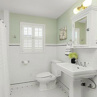 Small arts and crafts white tile and mosaic tile mosaic tile floor bathroom photo in Seattle with a two-piece toilet, green walls and a pedestal sink