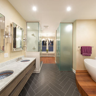Example of a large transitional master multicolored tile and ceramic tile ceramic floor bathroom design in Chicago with flat-panel cabinets, dark wood cabinets, beige walls, an undermount sink, a two-piece toilet, solid surface countertops and a hinged shower door