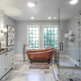 Example of a large classic master gray tile porcelain tile and gray floor bathroom design in Detroit with raised-panel cabinets, distressed cabinets, gray walls, an undermount sink, quartz countertops, a hinged shower door and black countertops