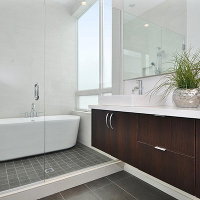 Bathroom - mid-sized contemporary master porcelain tile porcelain tile bathroom idea in Seattle with a vessel sink, flat-panel cabinets, dark wood cabinets, white walls and quartz countertops
