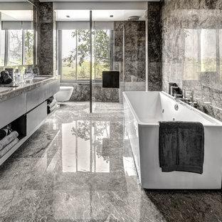 Неиссякаемый источник вдохновения для домашнего уюта: ванная комната среднего размера в современном стиле с стеклянными фасадами, врезной раковиной и столешницей из гранита