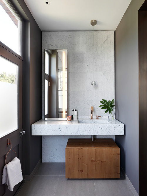 A Medium Sized Contemporary Bathroom In London With Freestanding Cabinets  Wood A Built