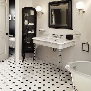 Elegant ceramic floor bathroom photo in Florence with white walls and a console sink