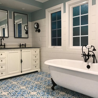 Drop-in bathtub - small contemporary black and white tile and ceramic tile ceramic tile and white floor drop-in bathtub idea in Other
