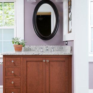 フィラデルフィアの中サイズのトランジショナルスタイルのおしゃれなバスルーム (浴槽なし) (シェーカースタイル扉のキャビネット、濃色木目調キャビネット、紫の壁、アンダーカウンター洗面器、御影石の洗面台、茶色い床、ベージュのカウンター、無垢フローリング) の写真
