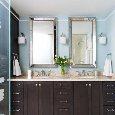 Mid-sized elegant beige tile travertine floor corner shower photo in Toronto with an undermount sink, shaker cabinets, dark wood cabinets and blue walls