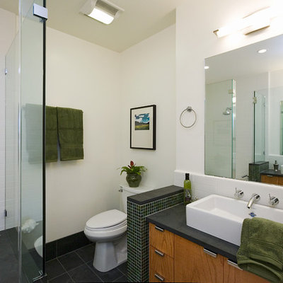 Tub/shower combo - contemporary white tile tub/shower combo idea in San Francisco with a vessel sink, flat-panel cabinets, medium tone wood cabinets, an undermount tub and a two-piece toilet