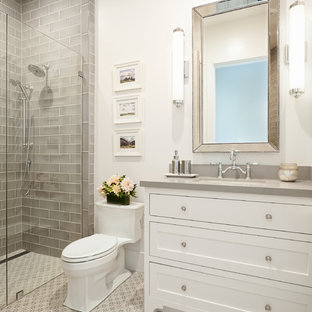 Inspiration for a farmhouse 3/4 gray tile and subway tile porcelain floor and gray floor alcove shower remodel in San Francisco with shaker cabinets, white cabinets, a one-piece toilet, white walls, an undermount sink, engineered quartz countertops, a hinged shower door and gray countertops