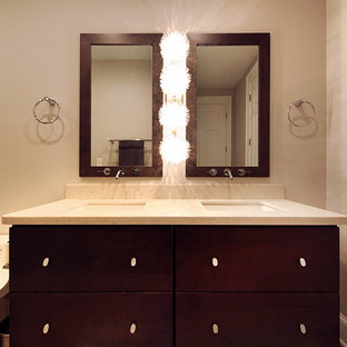 Example of a large trendy ceramic tile bathroom design in DC Metro with flat-panel cabinets and dark wood cabinets