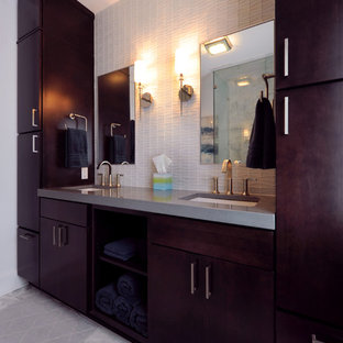 Example of a large trendy marble floor bathroom design in DC Metro with flat-panel cabinets and dark wood cabinets