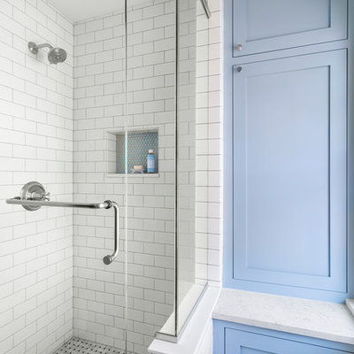 Example of a small classic kids' black and white tile and ceramic tile marble floor and gray floor corner shower design in Minneapolis with furniture-like cabinets, blue cabinets, a two-piece toilet, blue walls, an undermount sink, quartz countertops, a hinged shower door and white countertops