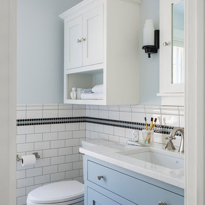 Inspiration for a small timeless kids' black and white tile and ceramic tile marble floor and gray floor corner shower remodel in Minneapolis with furniture-like cabinets, blue cabinets, a two-piece toilet, blue walls, an undermount sink, quartz countertops, a hinged shower door and white countertops
