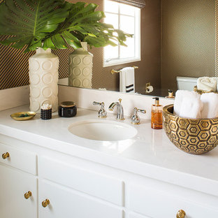 Inspiration for a transitional bathroom remodel in Los Angeles with flat-panel cabinets, white cabinets, multicolored walls and an undermount sink