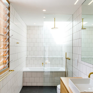 Contemporary master bathroom in Sydney with flat-panel cabinets, medium wood cabinets, an