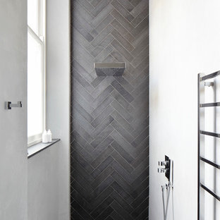 Contemporary bathroom in London with grey tiles.