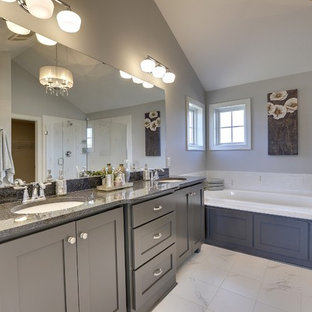 Example of a large master subway tile marble floor bathroom design in Minneapolis with an undermount sink, recessed-panel cabinets, black cabinets and gray walls