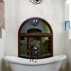 Mediterranean Bathroom by Tiara Sun Development LLC