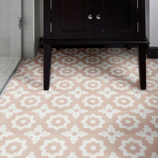 Design ideas for an arts and crafts bathroom in London with white tile, porcelain floors and pink floor.