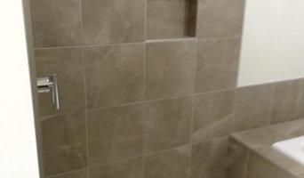 Enlarge bathroom, convert bedroom closet into bathroom shower. Full remodel.