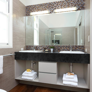 Photo of a small contemporary shower room in Brisbane with open cabinets, multi-coloured tiles, mosaic tiles, a built-in sink, grey cabinets, a walk-in shower, white walls, porcelain flooring and an open shower.