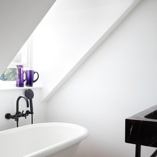 Design ideas for a small contemporary ensuite bathroom in Devon with a claw-foot bath, a shower/bath combination, white walls, medium hardwood flooring, a console sink, marble worktops, brown floors and an open shower.