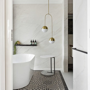 Photo of a contemporary bathroom in Geelong with a freestanding tub, white tile, white walls and multi-coloured floor.