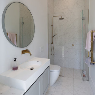 Inspiration for a small traditional shower room bathroom in Auckland with grey cabinets, a built-in shower, a one-piece toilet, grey tiles, marble tiles, white walls, marble flooring, marble worktops, grey floors, a hinged door, white worktops, recessed-panel cabinets and an integrated sink.