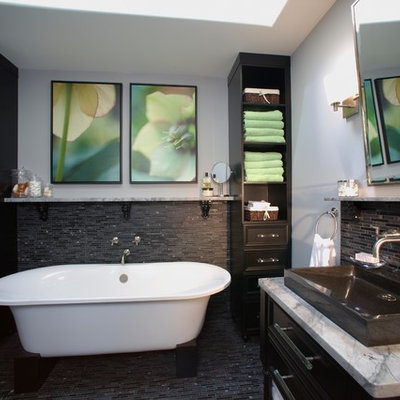Example of a trendy freestanding bathtub design in Calgary with a vessel sink