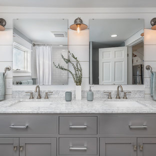 This is an example of a small transitional bathroom in Boston with shaker cabinets, grey cabinets, an alcove tub, an alcove shower, subway tile, grey walls, an undermount sink, marble benchtops, a shower curtain and grey benchtops.
