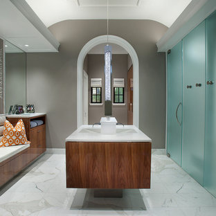 Large trendy master marble floor and white floor bathroom photo in Phoenix with an integrated sink, flat-panel cabinets, medium tone wood cabinets, marble countertops and gray walls